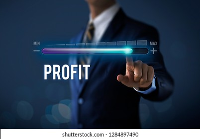 Profit growth, increase profit, raise profit or business growth concept. Businessman is pulling up progress bar with the word PROFIT on dark tone background.