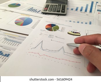 Profit and Loss analysis, business, account concept. and Business man hand pointing at business document during discussion at meeting.vintage tone