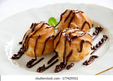 profiteroles with cream and chocolate sauce.