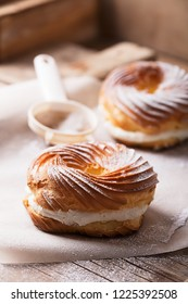 Profiteroles or eclair are small culinary products of French cuisine from dough with various fillings: cream, chocolate, caramel
