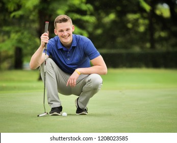 profressional golfer checking line for putting golf on green