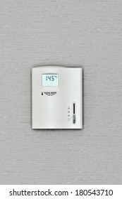 program the thermostat for heating a room