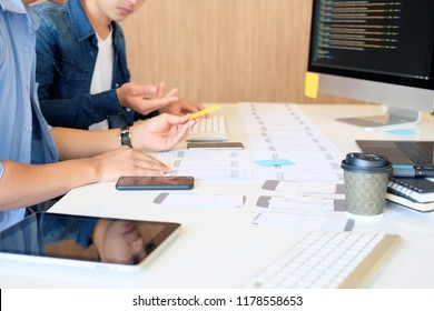 Programer Team working development software with UX UI project in computer and paper project.