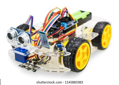 Programmable four wheels drive (4WD) robotic car with obstacle avoidance and line follow ability, isolated on white background with clipping path