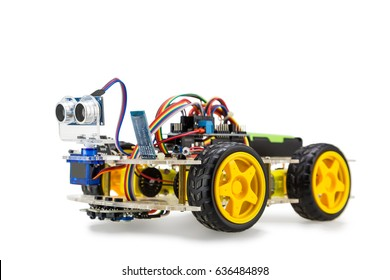 Programmable four wheels drive (4WD) robotic car with obstacle avoidance and line follow ability