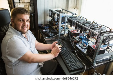 Programmer configures the computer for bitcoin mining
