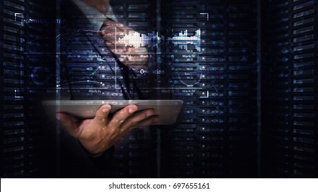 Programmer in data center and his tablet for working background : network security computer data base concept