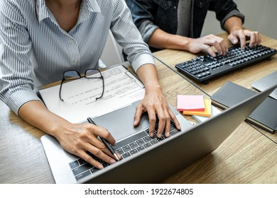 Programmer Team of  Developing programming and website working in a software develop company office, writing codes and typing data code, Programming with HTML, PHP and javascript.