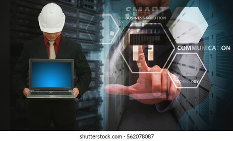 Programmer touch the icon in data center room