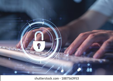 A programmer is typing a code on a keyboard to protect a cyber security from hacker attacks and save clients confidential data. Padlock Hologram icons over the typing hands.