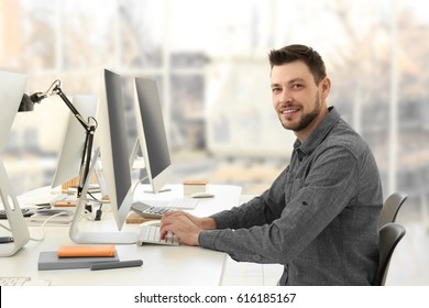 Programmer working in office
