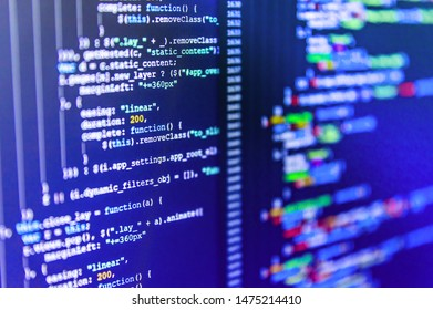 Programmer working in a software develop company office. Database bits access stream visualisation. Programming code abstract background screen of software