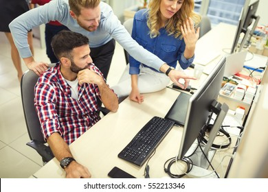 Programmers cooperating at  IT company developing apps