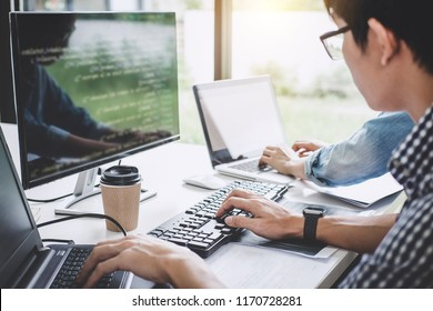 Programmers cooperating at Developing programming and website working in a software develop company office, writing codes and typing data code.