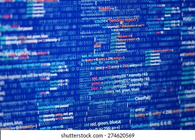 Programming abstract - source code and binary code on display of software developer. Blue theme.