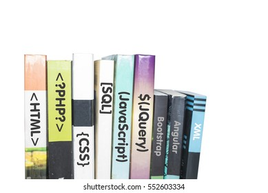 "Programming books stacked with word ""HTML"", ""PHP"", ""CSS"", ""SQL"", ""Javascript"", ""JQuery"", ""Bootstrap"", ""Angular"" and ""XML"" in isolated white background. Selective focus."