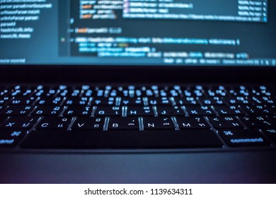 Programming in computer system of programmers in dark room.