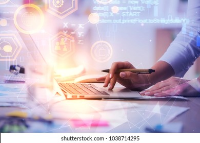 Programming, computing and internet concept. Close up of hands using laptop on abstract background with HTML code. Double exposure