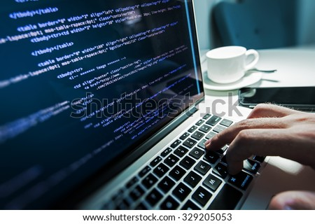 Programming Work Time. Programmer Typing New Lines of HTML Code. Laptop and Hand Closeup. Working Time. Web Design Business Concept.