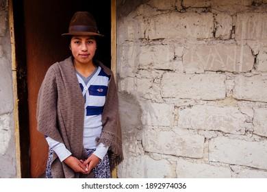 PROGRESO, ECUADOR - JANUARY 8, 2021: Portraits of local Ecuadorians near Quilatoa Lake, Ecuador.