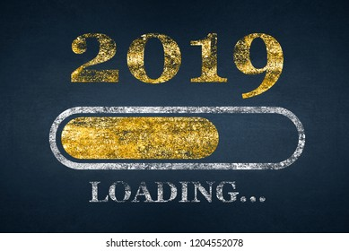Progress bar showing loading of 2019. New Year loading. Chalk Drawing. New year 2019 loading on Blackboard
