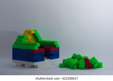 An in progress building of house using toy brick
