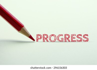 Progress word is standing on the paper with red pencil aside.