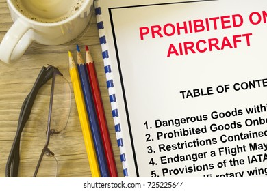 Prohibited goods on boarding a flight concept- with topics on a cover sheet.