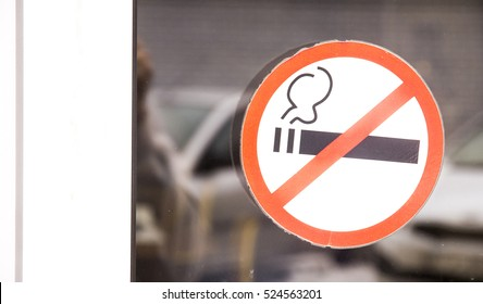 Prohibiting sign on the glass door to the shopping center no smoking