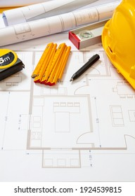 Project blueprints and labor worker hardhat yellow color, Housing project construction, construction site office background.