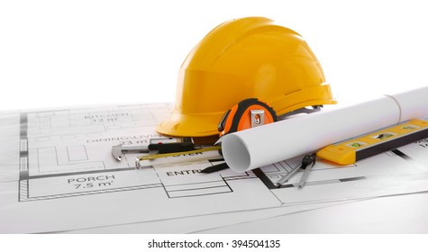 Project drawings and yellow helmet isolated on white