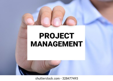 PROJECT MANAGEMENT, message on the card shown by a man