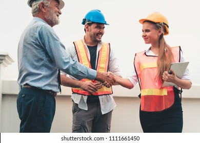 Project management team of engineers and architects are handshake together after dealing their project., Business construction concepts.