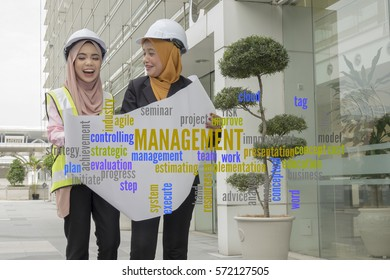 Project management word cloud and background of 2 young female engineers.