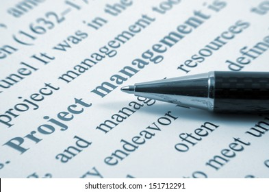 Project management writing and pen closeup