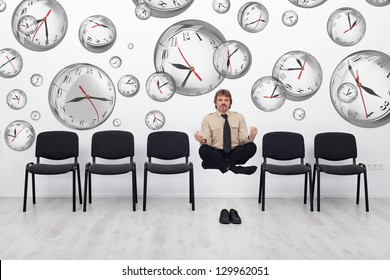 Project manager juggling with deadlines - surrounded by distorted wall clock bubbles