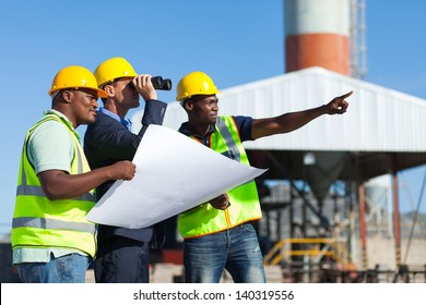 project manager visiting construction site with construction workers