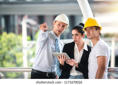 Project Manager Working and Discusses with Professional Engineering Team Training on Construction Site and Building - Teamwork Business Concept