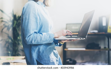Project manager working process. Photo young business wooman work with new startup. Holding modern notebook hands. Blurred, film effect. Horizontal