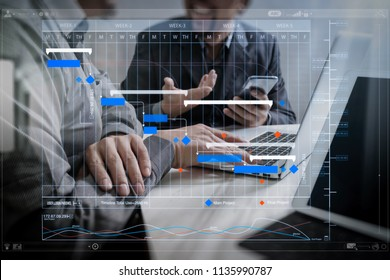 Project manager working and update tasks with milestones progress planning and Gantt chart scheduling virtual diagram.Business team meeting. Photo professional investor working new start up project.