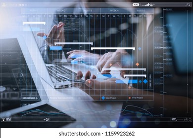 Project manager working and update tasks with milestones progress planning and Gantt chart scheduling virtual diagram.professional investor working new start up project. Finance task.