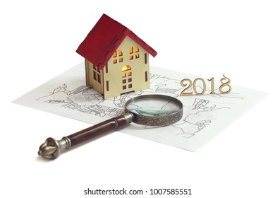 Project of Small wooden house on cadastral map of territory with magnifying glass isolated on white. Business concept, legal and juristic legislation, consulting, new laws in 2018.