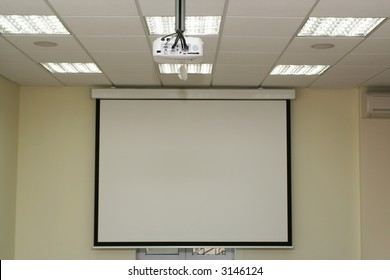 Projection screen in the boardroom with overhead projector in office