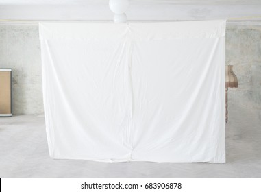 Projection screen in rural settings, blank white canvas