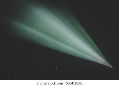 projector light rays in the dark