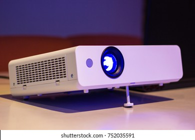 projector for presentation in a meeting room, (Light in a light yellow tone room).