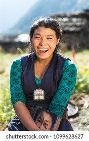 Prok village / Nepal - October 14 2017. Portrait of a beautiful smiling young nepalese woman in national clothes. Travel in Asia. Close up. Happy asian girl working on the field. Tribe in Himalayas