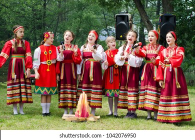 """Prokhorovka, Belgorod region, may 29, 2016 - the choir of girls in national Russian costumes sings a folk song at the Ethno festival """" Malanya"""""""