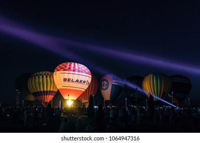 "Prokhorovka, Belgorod region, Russia -August 06, 2017: Festive night glow of balloons near the belfry at the memorial complex ""Prokhorovskoe pole"". Festival of aeronautics ""Nebosvod of Belogorie""."