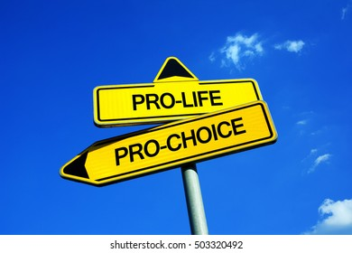 Pro-life vs Pro-choice - Traffic sign with two options - ethical dilemma of giving birth and forbidded termination or legal abortion. Freedom of mother vs value of human life